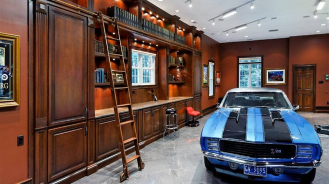 11 car garage with man cave for Cool car garage ideas